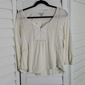 American Eagle cream top with floral embroidery